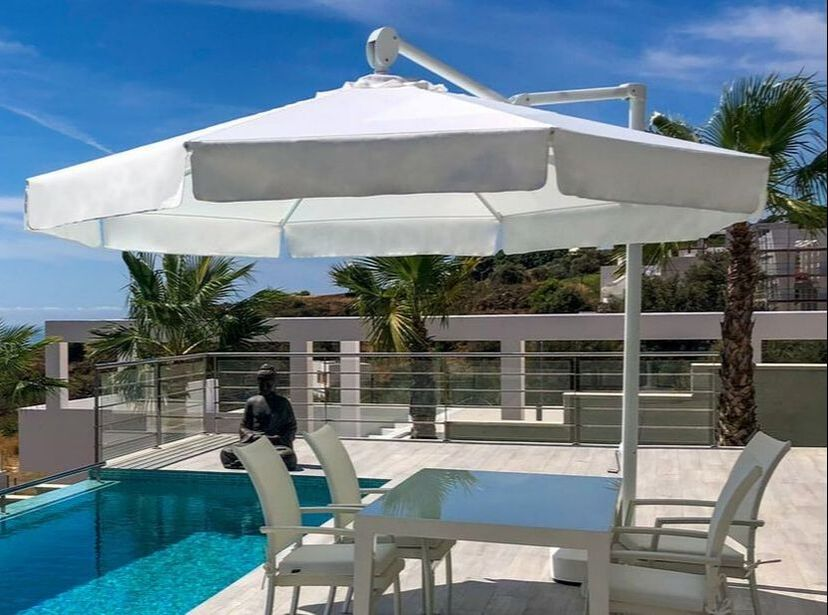 UMBRELLAS AND PARASOLS FOR TERRACE AND SWIMMING POOL